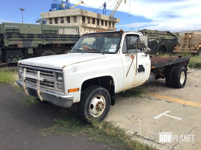 Surplus 1986 Chevrolet K30 4x4 Flatbed Truck in Pearl Harbor, Hawaii