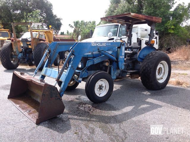 Surplus New Holland 7310 2WD Tractor w/Front End Loader in