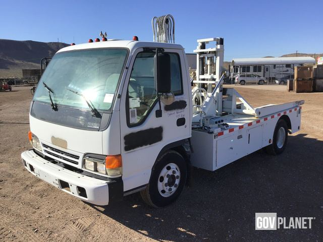 Surplus Amrep Dumpster Lift on 2002 Isuzu NPR Truck in Yermo