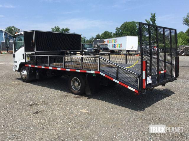 2014 Isuzu NPR S/A Flatbed Truck in Bristow, Virginia